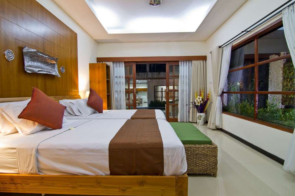 twin bedroom at villa maha with minimalist design - facing to the pool