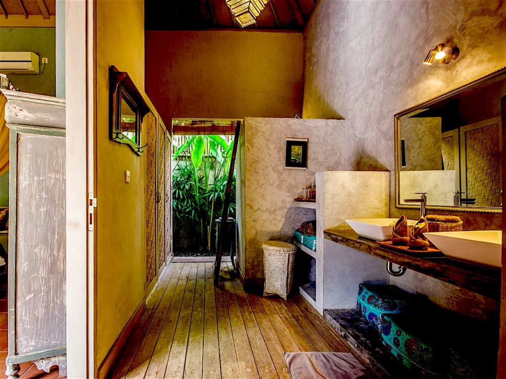 The villa bathroom with dual wash basin with its own garden